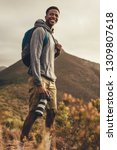 african man on hiking trip with ... | Shutterstock . vector #1309807618