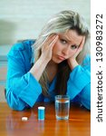 sick young woman with pills | Shutterstock . vector #130983272