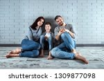 happy family sitting on the... | Shutterstock . vector #1309877098