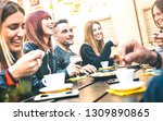 friends drinking cappuccino at... | Shutterstock . vector #1309890865