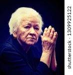 old sad gray haired woman... | Shutterstock . vector #1309925122