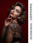portrait of attractive brunette ... | Shutterstock . vector #1309943902