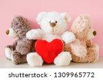 White Teddy Bear Holding Red...