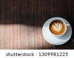 cup of espresso macchiato... | Shutterstock . vector #1309981225
