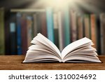stack of books in the library... | Shutterstock . vector #1310024692