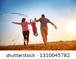 girl with mother and father... | Shutterstock . vector #1310045782