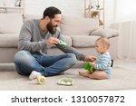 play time. millennial dad... | Shutterstock . vector #1310057872