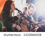 Duet Of Guitarists Singing...