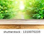 empty wooden table background | Shutterstock . vector #1310070235