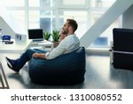 young businessman sitting on...   Shutterstock . vector #1310080552