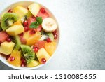 tropical fruit salad in a white ... | Shutterstock . vector #1310085655