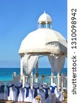 white wedding gazebo in a... | Shutterstock . vector #1310098942