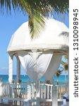 white wedding gazebo in a... | Shutterstock . vector #1310098945