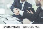 handshake business partners... | Shutterstock . vector #1310102758