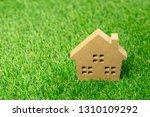 small model of house over green ... | Shutterstock . vector #1310109292