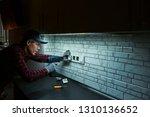 sockets installation. close up... | Shutterstock . vector #1310136652