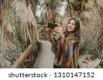 smiling young woman holding... | Shutterstock . vector #1310147152