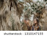 smiling young woman holding... | Shutterstock . vector #1310147155