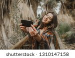 smiling young woman holding... | Shutterstock . vector #1310147158