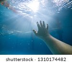 first person view. drowning man ... | Shutterstock . vector #1310174482