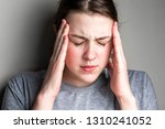 headache in the temples. sick... | Shutterstock . vector #1310241052