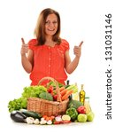 Young woman with variety of vegetables isolated on white background - stock photo
