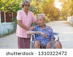 asian senior woman caring man...   Shutterstock . vector #1310322472
