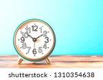 turquoise retro alarm clock on... | Shutterstock . vector #1310354638