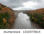 Autumn view of the Connecticut River from a tall bridge as fog lifts after the rain.