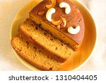 top view of rich plum cake...   Shutterstock . vector #1310404405