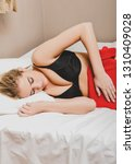 woman with stomach pain putting ... | Shutterstock . vector #1310409028