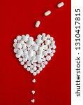 white pills goes through the... | Shutterstock . vector #1310417815