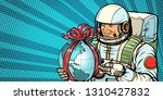 astronaut gives the planet... | Shutterstock .eps vector #1310427832