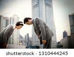 businessman and businesswoman... | Shutterstock . vector #1310444245
