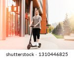 attractive young man riding a... | Shutterstock . vector #1310446825