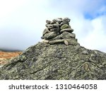 a pile of stones become a cairn ... | Shutterstock . vector #1310464058