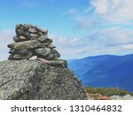 a pile of stones become a cairn ... | Shutterstock . vector #1310464832