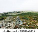 a pile of stones become a cairn ... | Shutterstock . vector #1310464835