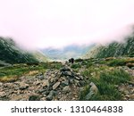 a pile of stones become a cairn ... | Shutterstock . vector #1310464838