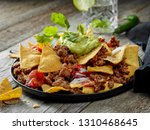 plate of corn chips nachos with ... | Shutterstock . vector #1310468645