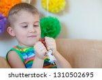kid holding stress relief grape ...   Shutterstock . vector #1310502695