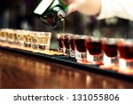 bartender pours alcoholic drink ... | Shutterstock . vector #131055806