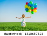 happy child playing with bright ... | Shutterstock . vector #1310657528