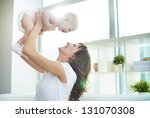 Portrait Of Joyful Mother And...