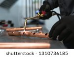 Worker Is Soldering A Pipe By ...