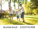 happy children play on the lawn | Shutterstock . vector #1310741408
