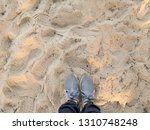 top view of shoes on tropical...   Shutterstock . vector #1310748248