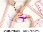 girl's hands decorate bright... | Shutterstock . vector #1310784398