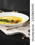 pea soup with pieces of bacon ...   Shutterstock . vector #1310845445