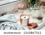 Small photo of Elegant home decoration with wooden wick burning candle